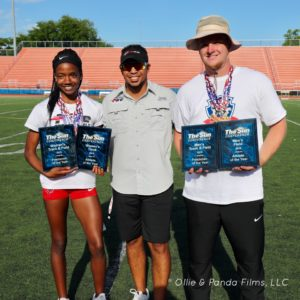 Coach Nick Dodson with two Southeastern University athletes